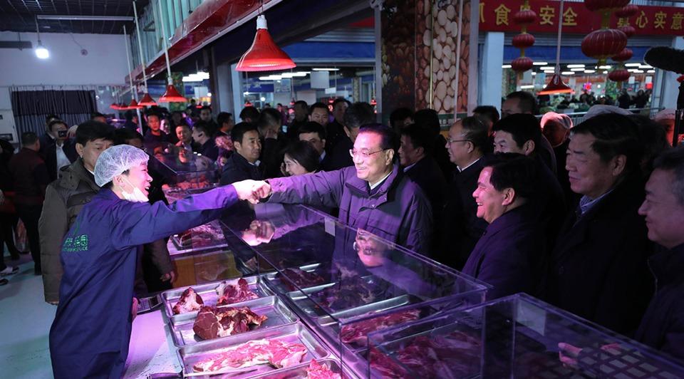 Premier Li urges stable market:1