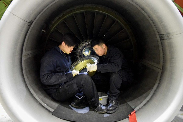 Mechanical engineers offer maintenance service to airplanes to ensure flight safety:null